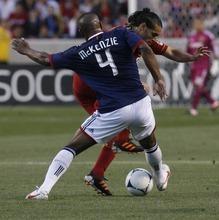 Rick Egan  | The Salt Lake Tribune   Real Salt Lake's Fabian Espindola (7) tries to get past Chivas USA's Rauwshan McKenzie, in MLS soccer action in Sandy, Saturday, March 24, 2012.