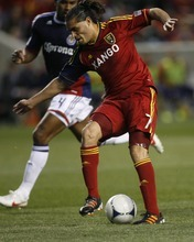 Rick Egan  | The Salt Lake Tribune   Real Salt Lake's Fabian Espindola (7) contols the ball, as Rauwshan McKenzie defends for Chivas USA, in MLS soccer action in Sandy, Saturday, March 24, 2012.