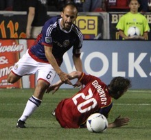 Rick Egan  | The Salt Lake Tribune   Real Salt Lake's Nat Borchers (6) is knocked down by  Peter Vagenas, Chivas USA, in MLS soccer action in Sandy, Saturday, March 24, 2012.