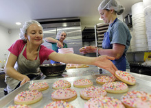 Al Hartmann  |  The Salt Lake Tribune Assistant Manager Cristen Carrell, left, baking intern Kylee Ellswroth and co-founder and executive baker Nicole Lawson work together March 23 to make 400 gluten-free sugar cookies at New Grains Gluten-Free Bakery in Provo.