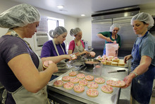 Al Hartmann  |  The Salt Lake Tribune Employee Kendra Clark, left, baking intern Maggie Arnoldus, Assistant Manager Cristen Carrell, baking intern Kylee Ellswroth and co-founder and executive baker Nicole Lawson work together Friday March 23 to make 400 gluten free sugar cookies in the basement of Tim Lawson's Provo home.