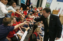 Francisco Kjolseth  |  The Salt Lake Tribune Governor Gary R. Herbert gets a few fist bumps and hand shakes from third-graders at Falcon Ridge Elementary in West Jordan following a flag ceremony where the governor signed three education-related bills on Tuesday, March 27, 2012.