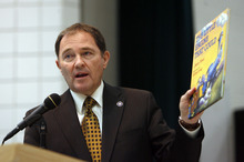 Francisco Kjolseth  |  The Salt Lake Tribune Gov. Gary Herbert illustrates his point about moving education forward with the classic book