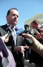 Matt Canham  |  The Salt Lake Tribune Sen. Mike Lee, R-Utah, talks with reporters after Tuesday's Supreme Court hearing on health reform.