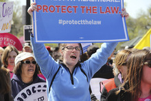 Laura Schmitz  |  The Salt Lake Tribune A woman chants with other protesters in support of keeping Pres. Obama's health care law intact. Protesters rallied for hours on the steps of the U.S. Supreme Court on Tuesday, March 27, 2012.