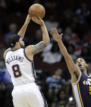 New Jersey Nets' Deron Williams (8) shoots against Utah Jazz's Devin Harris in the first quarter of an NBA basketball game, Monday, March 26, 2012, in Newark, N.J. (AP Photo/Julio Cortez)