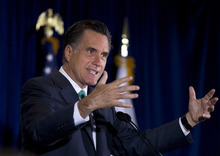Republican presidential candidate, former Massachusetts Gov. Mitt Romney gestures while speaking at NuVasive, Inc., a medical device company, Monday, March 26, 2012, in San Diego, Calif. (AP Photo/Steven Senne)