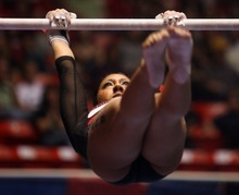 Kim Raff | The Salt Lake Tribune University of Utah gymnast Kassandra Lopez competes on the uneven bars during the Pac 12 Gymnastics Championship at the Huntsman Center in Salt Lake City, Utah on March 24, 2012.
