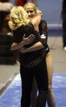 Kim Raff | The Salt Lake Tribune University of Utah gymnast Kyndal Robarts gets a hug from her coach Megan Marsden after her performance on the beam during the Pac 12 Gymnastics Championship at the Huntsman Center in Salt Lake City, Utah on March 24, 2012.