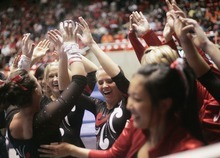 Kim Raff | The Salt Lake Tribune University of Utah gymnast Stephanie McAllister is congratulated by her team for her performance on the uneven bars during the Pac 12 Gymnastics Championship at the Huntsman Center in Salt Lake City, Utah on March 24, 2012.