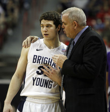 Rick Egan  | Salt Lake Tribune  BYU head coach Dave Rose talks to BYU guard Jimmer Fredette (32), during a break in the action,  BYU vs. TCU, in the Mountain West Conference Championships in Las Vegas, Thursday, March 10, 2011