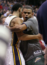 Steve Griffin  |  The Salt Lake Tribune   Utah guards Devin Harris, left, and Earl Watson embrace as the Jazz starters take the floor at the start of their game against the Clippers game at EnergySolutions Arena in Salt Lake City, Utah  Wednesday, February 1, 2012.