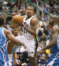 Paul Fraughton  |  The Salt Lake Tribune Utah Jazz point guard Earl Watson (11)drives to the basket and passes the ball to an open Utah Jazz shooting guard Raja Bell (19) for a three point play.The Utah Jazz played the New Orleans Hornets at Energy Solutions Arena  on , Thursday  March 24, 2011