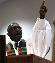 Salt Lake City,UT--12/31/06--12:23:47 PM--  The Rev. France Davis delivers the gospel sermon during the worship service Sunday morning at Calvary Baptist Church.  ***************** His autobiography -- we need an action shot and he'll be preaching on Sun at 11:00 a.m. So try to get him behind the pulpit or at the altar -- anything that shows him at work: sermonizing, blessing congregants, reception line, praying, etc. His eyes are very impressive if you can get a close-up. He has a quiet charisma, not flamboyant.   Chris Detrick/Salt Lake Tribune File #_1CD2100