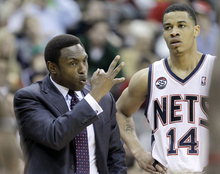 New Jersey Nets coach Avery Johnson, left, talks to Gerald Green in the fourth quarter of an NBA basketball game against the Utah Jazz, Monday, March 26, 2012, in Newark, N.J. The Jazz won 105-84. (AP Photo/Julio Cortez)
