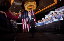 Republican presidential candidate former Massachusetts Gov. Mitt Romney walks to speak to supporters at his Nevada caucus night victory celebration in Las Vegas, Saturday, Feb. 4, 2012.  (AP Photo/Julie Jacobson)