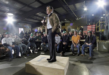 Jim Cole  |  AP file photo Republican presidential candidate Mitt Romney speaks during a campaign stop with mill workers at the Madison Lumber Mill in Madison, N.H., on Dec. 12, 2011.
