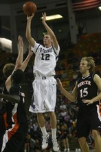 Kim Raff | The Salt Lake Tribune Utah State University player Danny Berger takes a shot against Mercer during the CollegeInsider.com Tournament championship game Wednesday night in Logan.  Mercer went on to win 70-67.