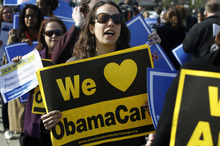 Supporters of health care reform stand in front of the Supreme Court in Washington, Wednesday, March 28, 2012, on the final day of arguments regarding the health care law signed by President Barack Obama. (AP Photo/Charles Dharapak)
