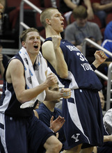 BYU guard/forward Brock Zylstra, left, and Nate Austin (33) react in the second half of their NCAA tournament second-round college basketball game against Marquette in Louisville, Ky., Thursday, March 15, 2012. Marquette defeated BYU 88-68. (AP Photo/John Bazemore)