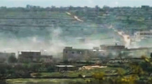 In this image made from amateur video and released by Ugarit News Wednesday, March 28, 2012, purports to show smoke leaping the air from shelling in Idlib, Syria. Syrian activists said Wednesday a government offensive in northern Syria during which troops overran a major opposition stronghold has left behind scenes of destruction, with corpses in the streets, homes burned to the ground and shops that have been pillaged and looted. (AP Photo/Ugarit News via APTN) THE ASSOCIATED PRESS CANNOT INDEPENDENTLY VERIFY THE CONTENT, DATE, LOCATION OR AUTHENTICITY OF THIS MATERIAL. TV OUT