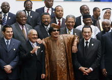 In this Oct. 10, 2010 file photo, Libyan leader Moammar Gadhafi, center, with Egyptian President Hosni Mubarak, right, and his Yemeni counterpart Ali Abdullah Saleh, center left, pose for a group photo with Arab and African leaders during the second Afro-Arab summit in Sirte, Libya. (AP file photo)