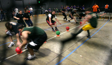 Steve Griffin  |  The Salt Lake Tribune  Dodgeball teams sprint for the balls during the Beehive Sport and Social Club adult league at The Complex in Salt Lake City on Wednesday, March 14, 2012.
