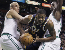 Elise Amendola  |  The Associated Press  Utah Jazz forward Derrick Favors (15) drives between Boston Celtics center Greg Stiemsma, left, and forward Brandon Bass, right, in the first half of an NBA basketball game in Boston on Wednesday.