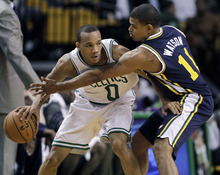Elise Amendola  |  The Associated Press  Utah Jazz guard Earl Watson (11) defends Boston Celtics guard Avery Bradley (0) in the first half of an NBA basketball game in Boston on Wednesday.