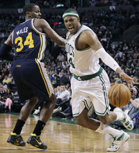 Elise Amendola  |  The Associated Press  Boston Celtics forward Paul Pierce, right, drives against Utah Jazz forward C.J. Miles (34) in the second half of an NBA basketball game in Boston on Wednesday.