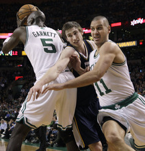 Elise Amendola  |  The Associated Press  Boston Celtics forward Sasha Pavlovic (11) runs toward the basket as Utah Jazz guard Gordon Hayward, middle, tries to fight his way through a pick set by forward Kevin Garnett (5) in the second half of an NBA basketball game in Boston on Wednesday.
