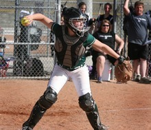 Paul Fraughton | The Salt Lake Tribune. Olympus High's Paula Felice fires the ball to first base in a recent game against Tooele High School  Thursday, March 22, 2012