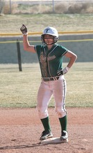 Paul Fraughton | The Salt Lake Tribune. Nicole Rockwood stands on second base doing a victory dance after hitting an RBI doublein a recent game against Tooele High School.  Thursday, March 22, 2012