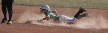 Paul Fraughton | The Salt Lake Tribune. Olympus High's Nicole Rockwood slides into second base in a recent game against Tooele High.