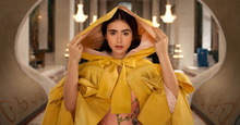In this image released by Relativity Media, Lily Collins portrays Snow White in Relativity Media's