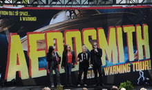 Joe Perry, from left, Steven Tyler, Joey Kramer, and  Tom Hamilton of Aerosmith, speak at the Aerosmith news conference announcing the 2012 Global Warming Tour, Wednesday, March 28, 2012, at The Grove in Los Angeles. The Global Warming Tour will play 18 markets beginning on June 16, 2012, in Minneapolis. (AP Photo/Katy Winn)