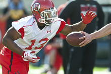 Chris Detrick  |  The Salt Lake Tribune Utah Utes Kelvin York runs the ball during practice at Rice-Eccles Stadium Tuesday March 20, 2012.