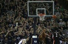 Kim Raff | The Salt Lake Tribune Utah State University fans make a lot of noise as Mercer player Travis Smith shots a free throw during the CIT Championship game at Utah State University in Logan, Utah on March 28, 2012.  Mercer went on to win the game 67-70.