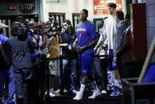Kansas forward Thomas Robinson, center, and center Jeff Withey, right, leave the locker room for a news conference in New Orleans, Thursday, March 29, 2012. Kansas is scheduled to play Ohio State in an NCAA tournament Final Four semifinal college basketball game on Saturday. (AP Photo/Gerald Herbert)