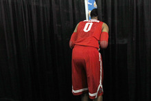 Ohio State forward Jared Sullinger peeks through a curtain while teammates participate in interviews in New Orleans, Thursday, March 29, 2012. Ohio State is scheduled to play Kansas in an NCAA tournament Final Four semifinal college basketball game on Saturday. (AP Photo/Gerald Herbert)