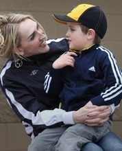 Rick Egan  | The Salt Lake Tribune   Jennafer Jeppsen, with her 4-year-old son, Crew Jeppsen at the baseball park in South Jordan, Wednesday, March 28, 2012. Crew has autism.