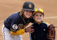 Rick Egan  | The Salt Lake Tribune   Baylor Jeppsen, with his 4-year-old brother Crew Jeppsen at the baseball park in South Jordan on Wednesday, March 28, 2012. Crew has autism.