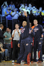 Oklahoma City Thunder guard Derek Fisher waves to fans as they cheer him prior to the Thunder's NBA basketball game against the Los Angeles Lakers, Thursday, March 29, 2012, in Los Angeles. Fisher signed with the West-leading Thunder last week, shortly after he was traded to Houston by the Lakers and subsequently bought out of his contract instead of playing for the Rockets. (AP Photo/Mark J. Terrill)