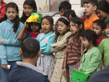 Leah Hogsten  |  The Salt Lake Tribune Hser Ner Moo's father, Cartoon Wah, listens as Burmese children sing during  a March 17 event for his slain daughter Hser Ner Moo in South Salt Lake.