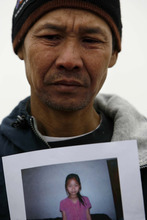 South Salt Lake - Holding a photograph of his missing  7-year-old daughter Hser Ner Moo, Cartoon Wah, speaks outside of the family's apartment in the South Parc complex, Tuesday, April 1, 2008.  Trent Nelson/The Salt Lake Tribune; 4.01.2008