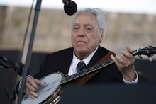 File  |  The Associated Press Earl Scruggs performs at the Newport Folk Festival in Newport, R.I. last year.