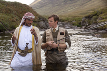 Sheikh Muhammad (Amr Waked, left) goes fishing with fish expert Dr. Alfred Jones (Ewan McGregor) in a scene from the comedy