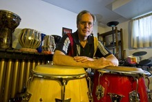 Tribune file photo Keith Guernsey, surrounded by some of the drums and percussion instruments he has collected over the years.