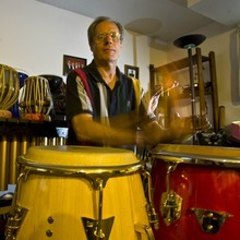 Percussionist, Keith Guernsey plays on a set of conga drums in his home studio. photo: paul fraughton 10/24/07