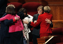 Scott Sommerdorf     The Salt Lake Tribune              Linda K. Burton, second from right, hugs another member of the Relief Society after a session of the 182nd Annual General Conference of The Church of Jesus Christ of Latter-day Saints, Saturday, March 31, 2012. Burton was one of three women taking their seats in the Relief Society after having been announced.